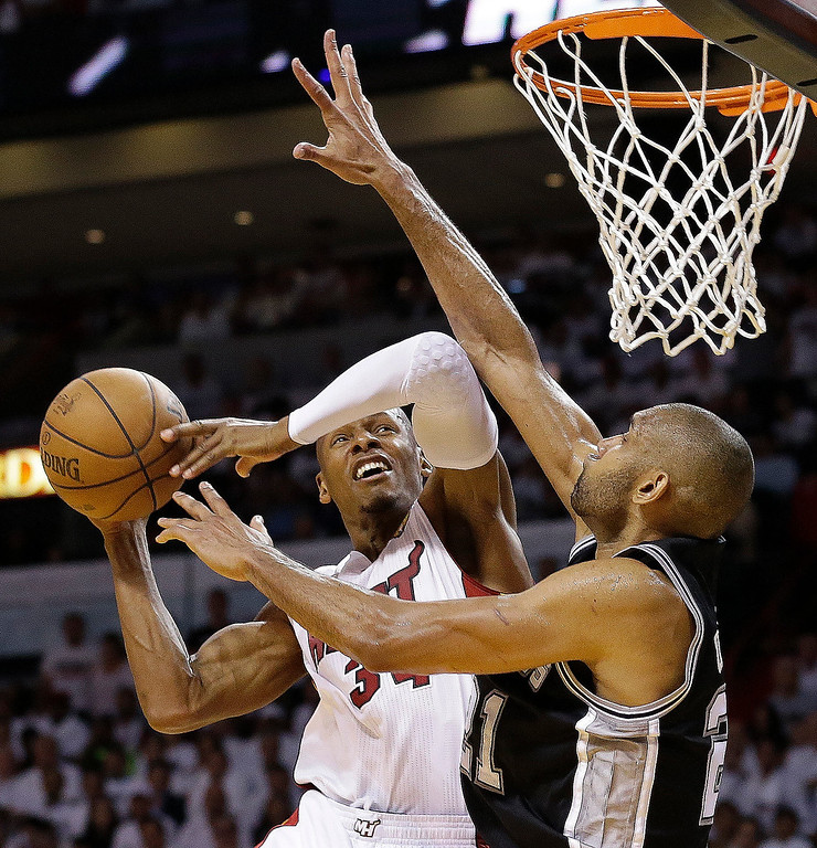 . Miami Heat shooting guard Ray Allen (34) is fouled by San Antonio Spurs power forward Tim Duncan (21) during the second half of Game 1 of the NBA Finals basketball game, Thursday, June 6, 2013 in Miami. (AP Photo/Lynne Sladky)