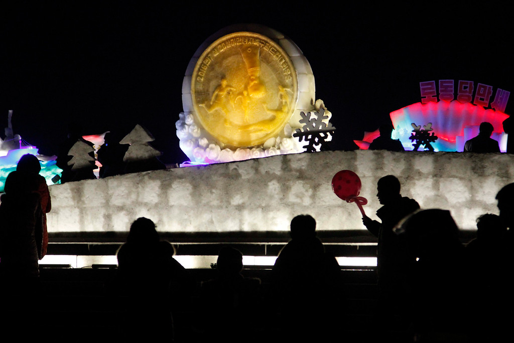 . North Koreans gather around an ice sculpture at an exhibition which opened in to mark the New Year at Kim Il Sung Square in Pyongyang, North Korea, Saturday, Dec. 31, 2016. (AP Photo/Jon Chol Jin)
