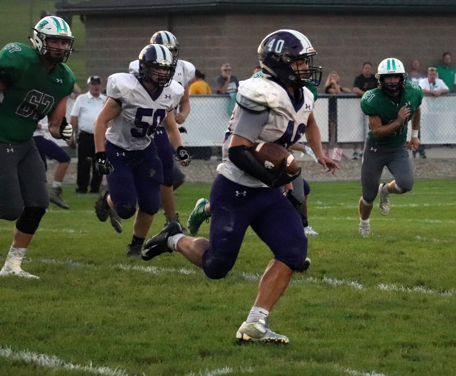 . Nicholas Pfeifer - The Morning Journal<br> Keystone\'s Dylan Naylor works to get around the end against Columbia on Sept. 14.