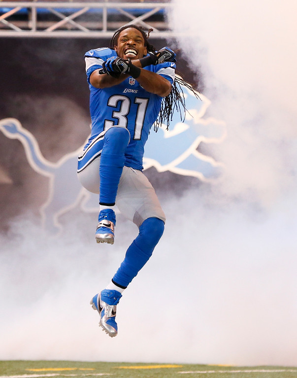 . Detroit Lions cornerback Rashean Mathis is introduced before the first half of an NFL football game against the Green Bay Packers in Detroit, Sunday, Sept. 21, 2014. (AP Photo/Rick Osentoski)