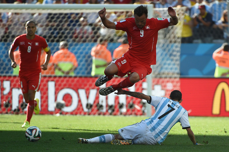 . Switzerland\'s forward Haris Seferovic (top) and Argentina\'s midfielder Angel Di Maria vie for the ball during the second half of extra-time in the Round of 16 football match between Argentina and Switzerland at the Corinthians Arena in Sao Paulo during the 2014 FIFA World Cup on July 1, 2014.  (CHRISTOPHE SIMON/AFP/Getty Images)
