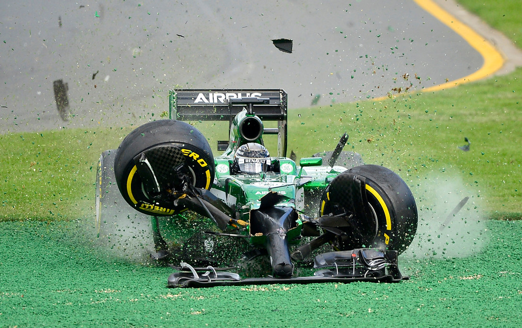 . Caterham driver Kamui Kobayashi of Japan runs off the track after he crashed with Williams driver Felipe Massa of Brazil on the first lap of the Australian Formula One Grand Prix at Albert Park in Melbourne, Australia, Sunday, March 16, 2014. Both Massa and Kobayashi walked away from the accident. (AP Photo/Ross Land, File)