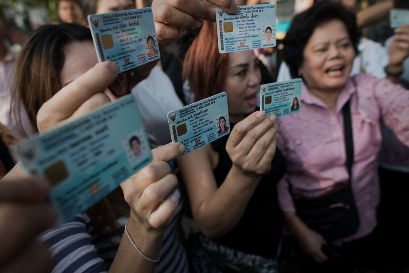 . Thai people who can\'t go cast their votes in their district show their national identification card and shout slogans as Thai police officers (not seen) secure and block a street leading to a polling station occupied by Thai anti-government protesters (not seen) in Bangkok on February 2, 2014. Polls opened on February 2 for tense elections in Thailand with opposition demonstrators preventing voting in parts of the country, a day after a gunfight between rival protesters in Bangkok raised fears of more violence. (NICOLAS ASFOURI/AFP/Getty Images)