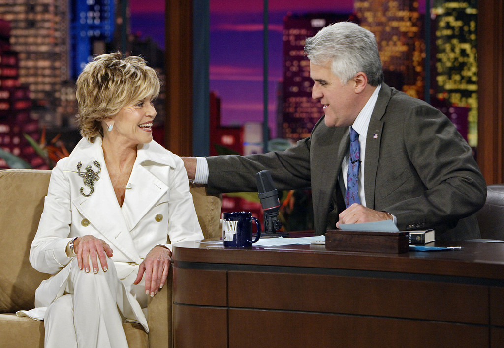 ". In this photo released by NBC studios, actress Jane Fonda speaks with Jay Leno during taping of ""The Tonight Show with Jay Leno,\"" on Thursday, April 28, 2005, in Burbank, Calif. (AP Photo/NBC, Paul Drinkwater)"