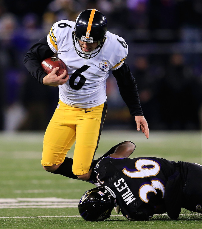 . Strong safety Jeromy Miles #36 of the Baltimore Ravens tackles kicker Shaun Suisham #6 of the Pittsburgh Steelers for a loss on a fake field goal attempt in the first half at M&T Bank Stadium on November 28, 2013 in Baltimore, Maryland.  (Photo by Rob Carr/Getty Images)