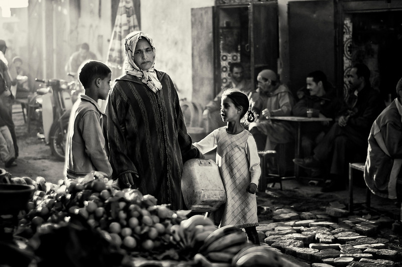 Mothers stressed out by there demanding children is a common thread shared by women of all cultures.  Marrakesh, Morocco, 2010.
