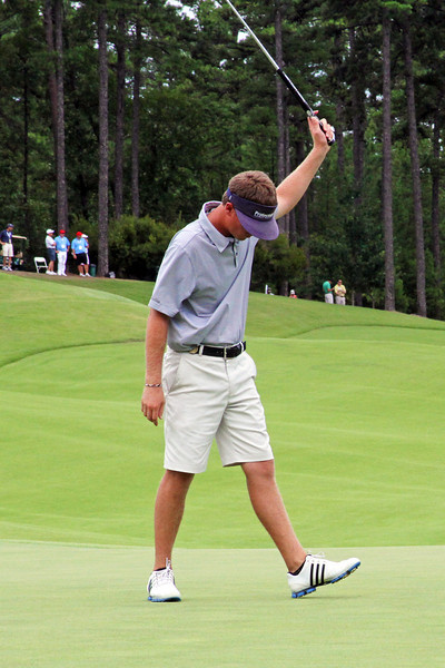Sean Dale of Jacksonville, FL celebrates after his putt on the 18th hole finished off medalist Patrick Rodgers of Avon, IN during the match play portion of the 111th Western Amateur at The Alotian Club in Roland, AR. (WGA Photo/Ian Yelton)