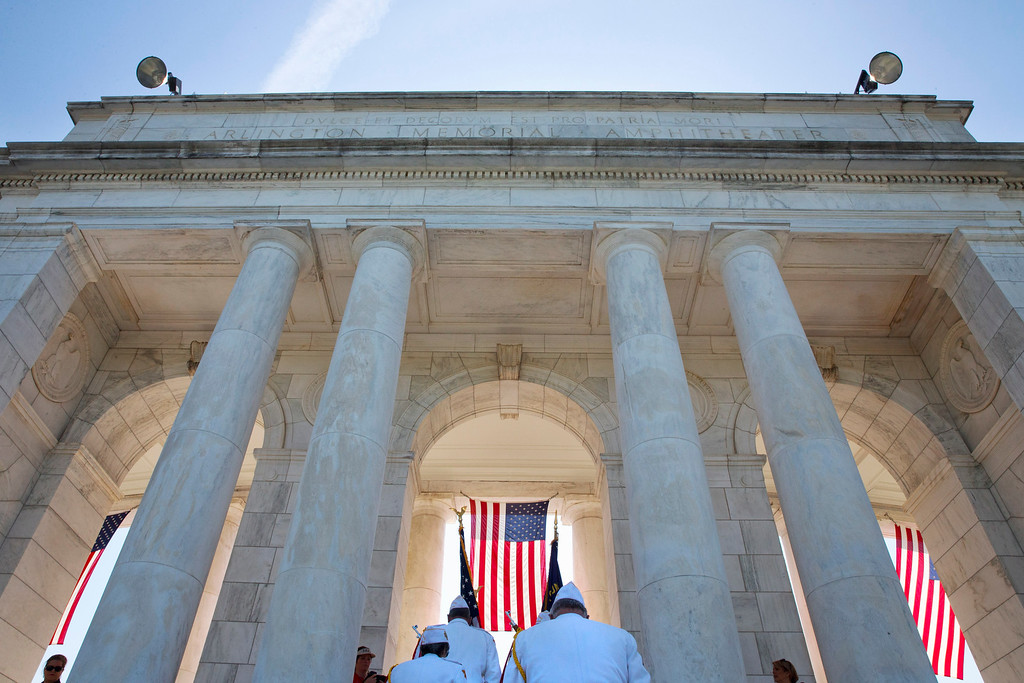 . Flags are carried into the Memorial Amphitheater prior to the start  of the Memorial Day ceremony at Arlington National Cemetery in Arlington, Va., Monday May 25, 2015, where President Barack Obama. (AP Photo/Jacquelyn Martin)