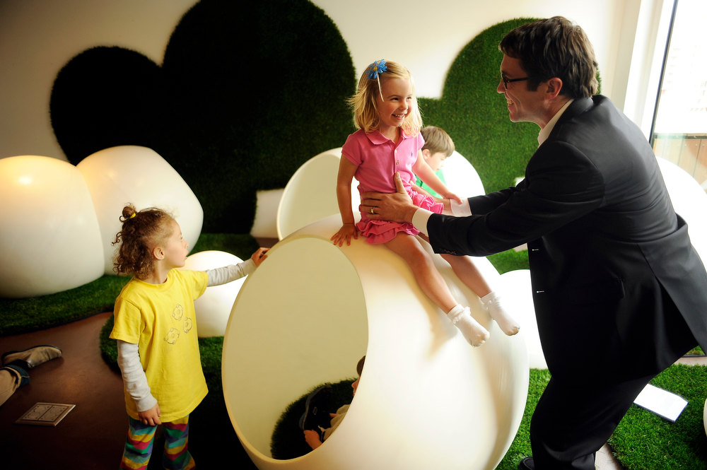 . From right, Architect Paul Andersen and his daughter Quinn, 3, are experiencing the Bubble Garden of Museum of Contemporary Art Denver in Denver, Colo., on Thursday, April 5, 2012.The DMA Denver added a new immersive family and children�s play-and-art-making space in the Fox Family Idea Box. Architect Paul Andersen of !ndie Architecture created The Bubble Garden, an other landscape of large plastic spheres synthetic turf. Hyoung Chang, The Denver Post