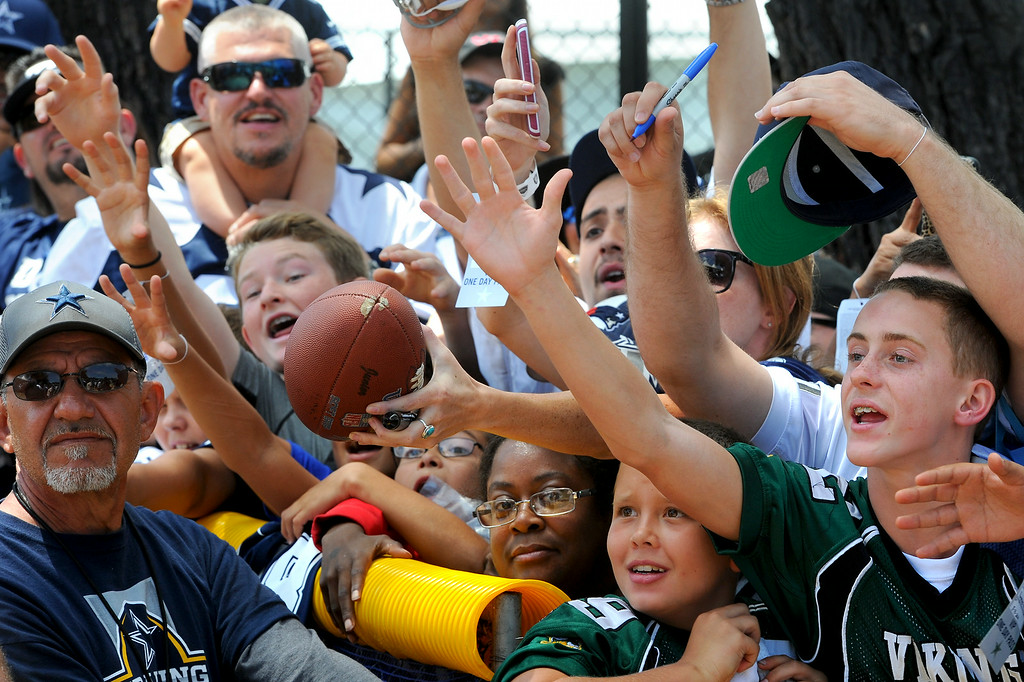 . Cowboys fans plead for autographs after the Cowboys-Raiders practice in Oxnard, Wednesday, August 13, 2014. (Photo by Michael Owen Baker/Los Angeles Daily News)