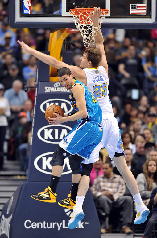 . DENVER, CO. - FEBRUARY 01: Austin Rivers of New Orleans Hornets #25 controls the ball against Timofey Mozgov of Denver Nuggets #25 in the 1st half of the game on February 1, 2013 at the Pepsi Center in Denver, Colorado. (Photo By Hyoung Chang/The Denver Post)