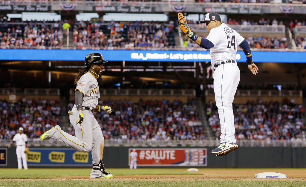 . American League first baseman Miguel Cabrera, of the Detroit Tigers, tags out National League\'s Andrew McCutchen, of the Pittsburgh Pirates, at first base during the fifth inning of the MLB All-Star baseball game, Tuesday, July 15, 2014, in Minneapolis. (AP Photo/Jeff Roberson)