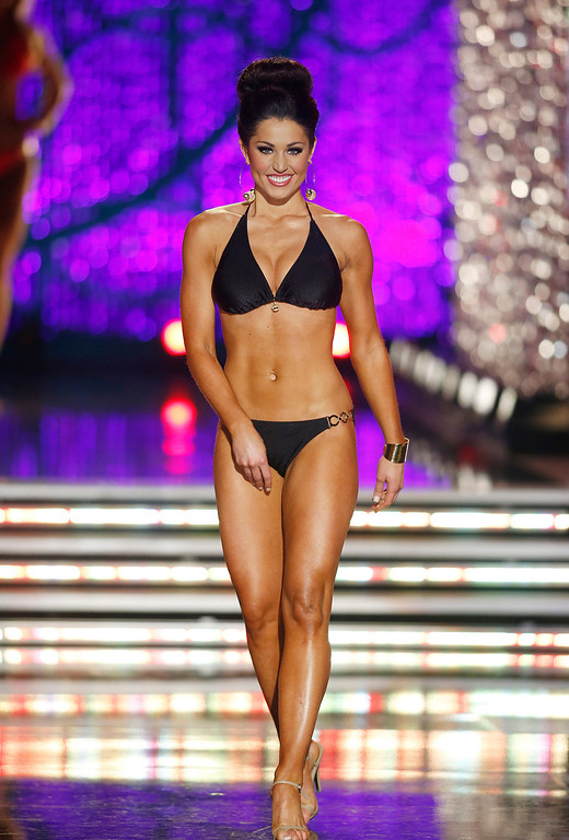 . Miss Illinois Megan Irvin competes in the swimsuit portion of the Miss America 2013 pageant on Saturday, Jan. 12, 2013, in Las Vegas. (AP Photo/Isaac Brekken)