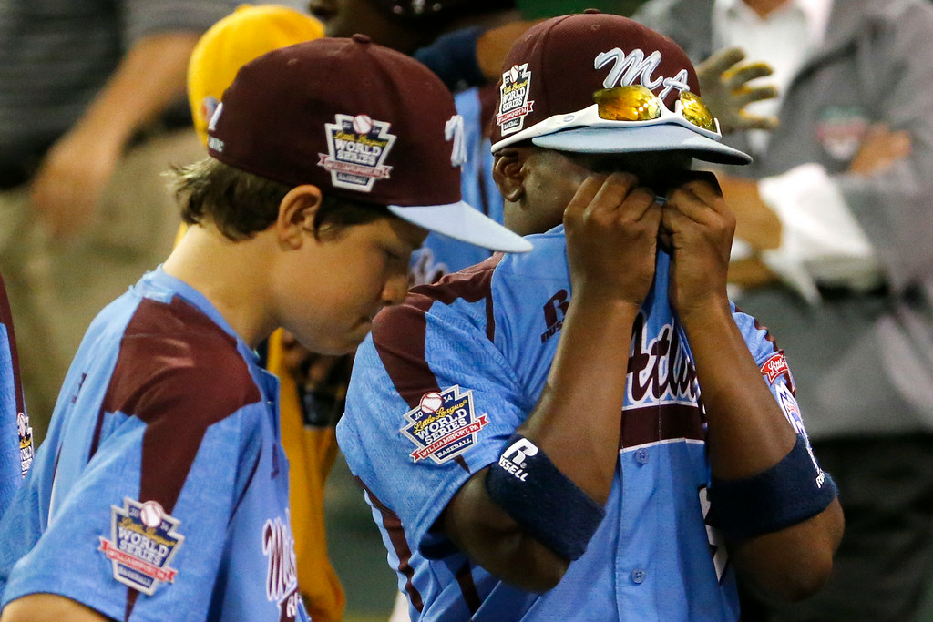 . Philadelphia\'s  Eli Simon, left, and Jahli Hendricks walk off the field after a 6-5 loss in an elimination baseball game against Chicago at the Little League World Series tournament in South Williamsport, Pa., Thursday, Aug. 21, 2014. (AP Photo/Gene J. Puskar)