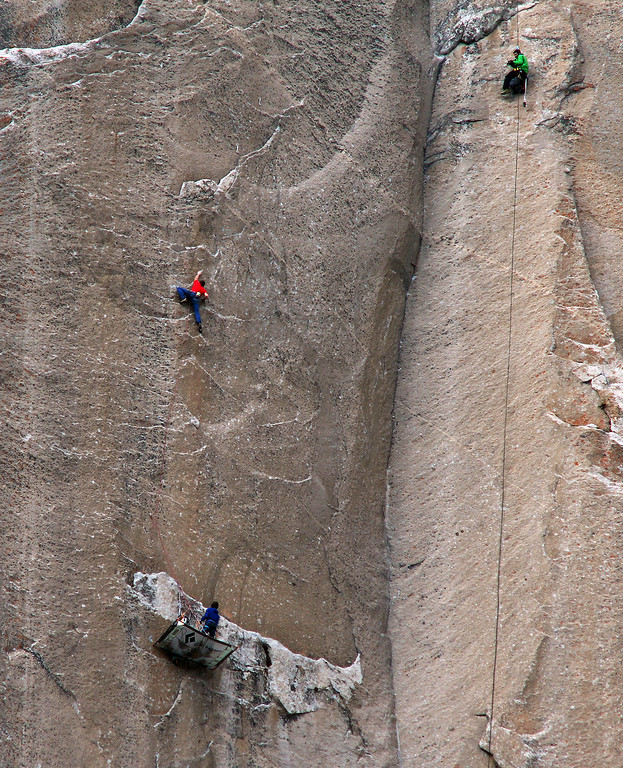 . In this Jan. 8, 2015 photo provided by Tom Evans, Tommy Caldwell, in red, climbs pitch 19 as Kevin Jorgeson, below, belays rope on a rest day as cameraman Brett Lowell records at top right during what has been called the hardest rock climb in the world: a free climb of El Capitan, the largest monolith of granite in the world, a half-mile section of exposed granite in California\'s Yosemite National Park. El Capitan rises more than 3,000 feet above the Yosemite Valley floor. The first climber reached its summit in 1958, and there are roughly 100 routes up to the top. (AP Photo/Tom Evans, elcapreport
