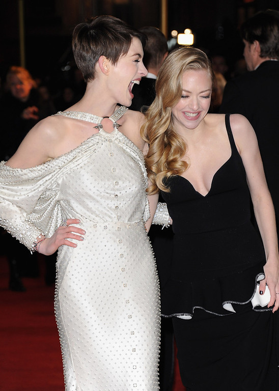 ". Actresses Anne Hathaway and Amanda Seyfriend attend the ""Les Miserables\"" World Premiere at the Odeon Leicester Square on December 5, 2012 in London, England.  (Photo by Stuart Wilson/Getty Images)"