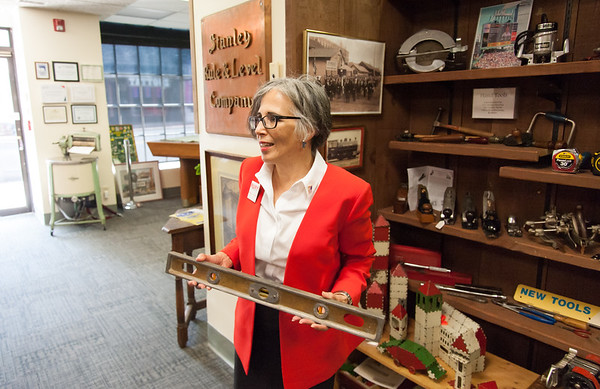 08/02/18 Wesley Bunnell | Staff Ruby Corby O'Neill holds a level manufactured in New Britain which is on display at the New Britain Industrial Museum during a stop on her tour of downtown New Britain. O'Neill is running for for Congress for Connecticut's 5th district.
