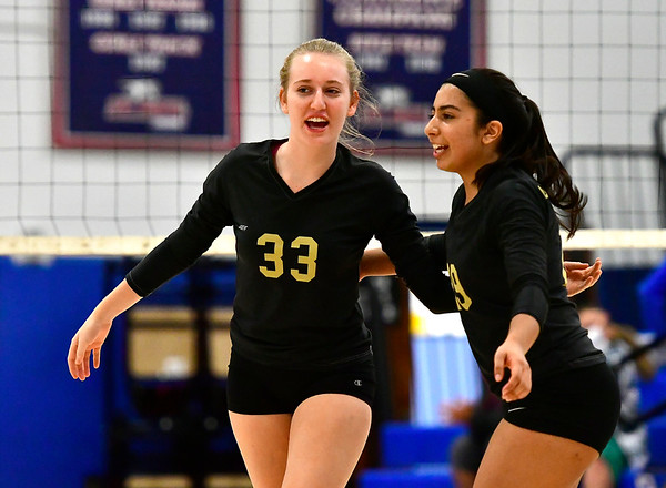9/27/2018 Mike Orazzi | Staff Woodland's Sydnie Overby (33) and Fatima Khalid (29) Thursday night in Bristol.