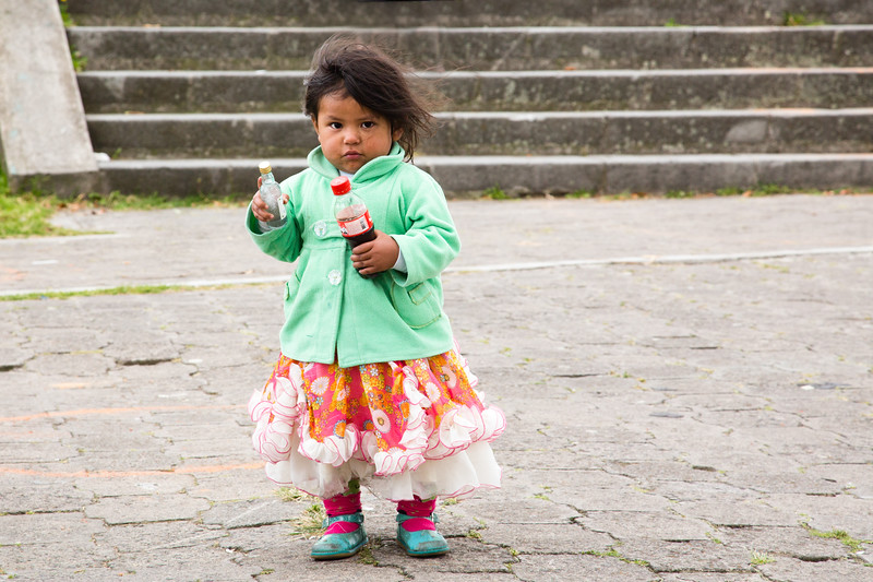 Little girl, wandering the tourist site.  I think she has vodka in one hand and a coke in another!