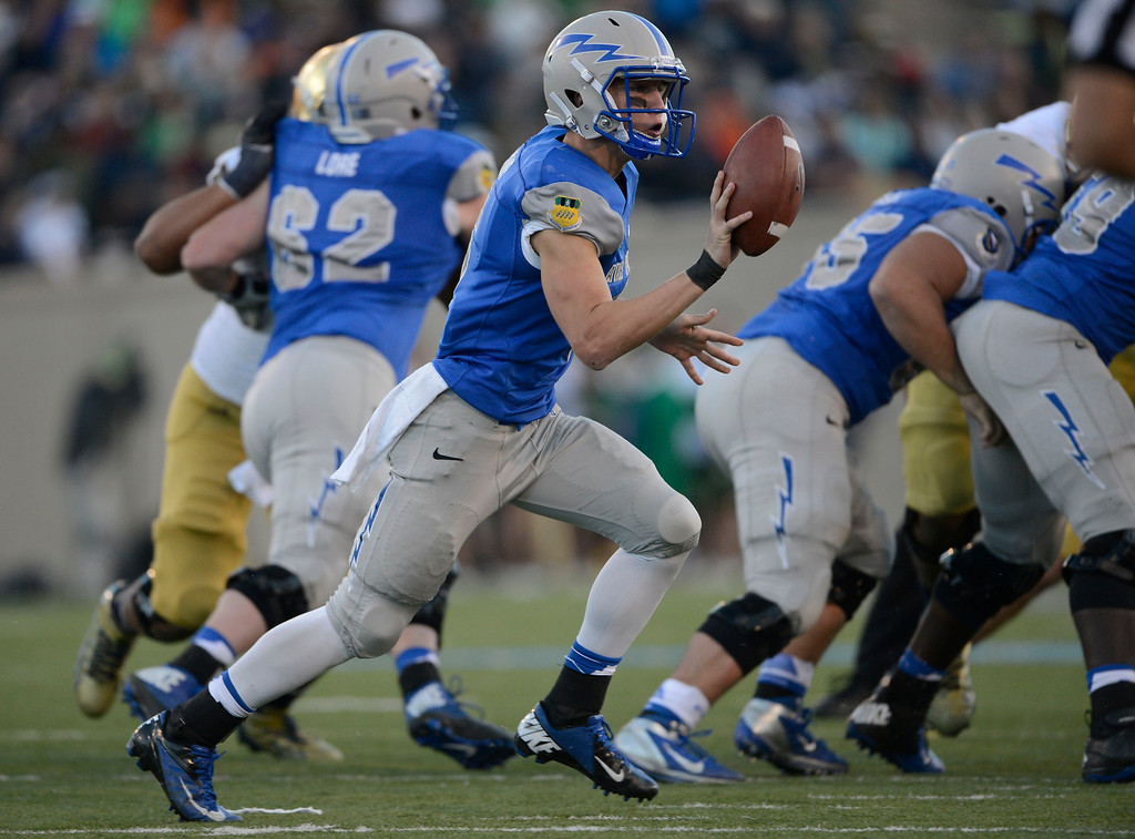 . COLORADO SPRINGS, CO - OCTOBER 26: Air Force QB, Nate Romine, on a pitch-out against Notre Dame in the third quarter at Falcon Stadium, Saturday afternoon, October 26, 2013. (Photo By Andy Cross/The Denver Post)