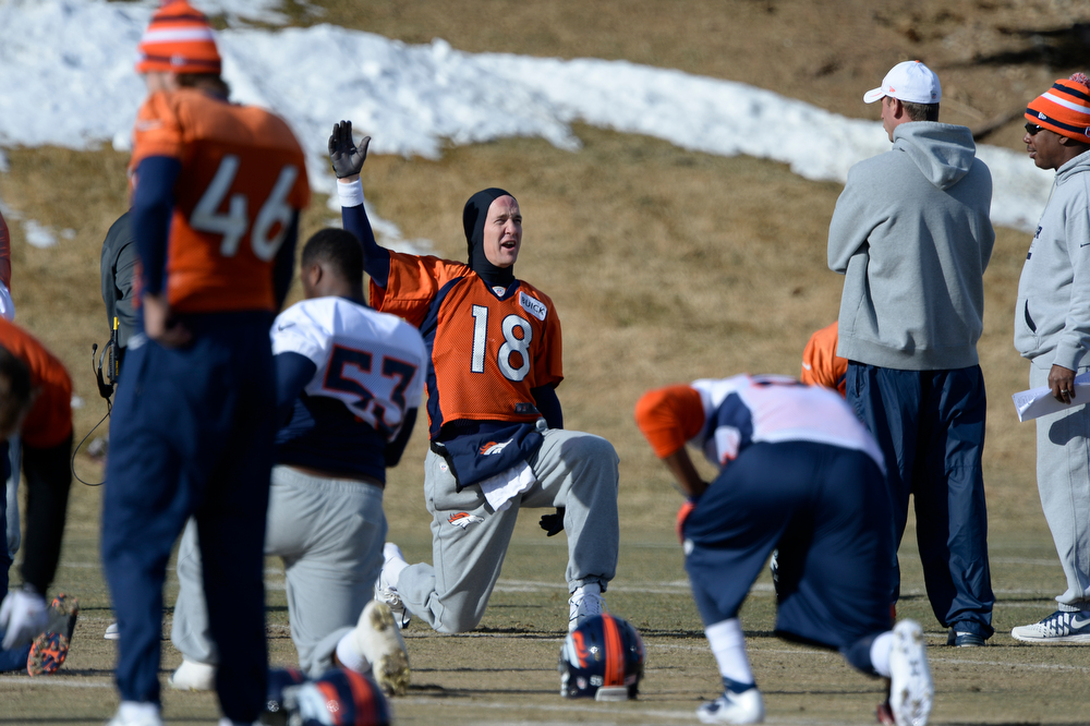 . Denver Broncos quarterback Peyton Manning (18) stretches before practice January 9, 2014 at Dove Valley (Photo by John Leyba/The Denver Post)