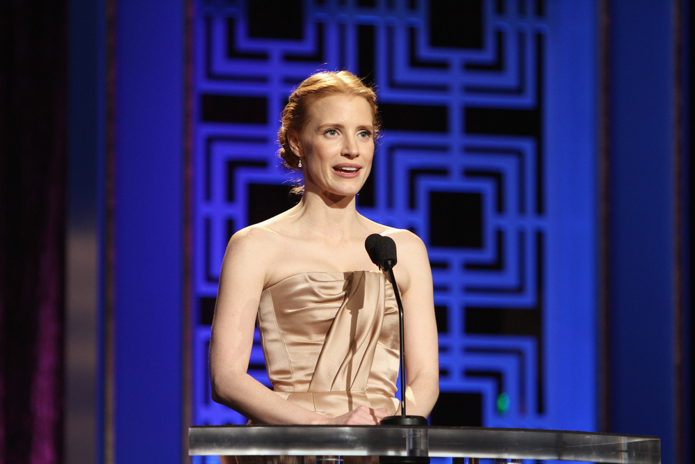 Description of . Actress Jessica Chastain speaks onstage at the 2013 WGAw Writers Guild Awards at JW Marriott Los Angeles at L.A. LIVE on February 17, 2013 in Los Angeles, California.  (Photo by Maury Phillips/Getty Images for WGAw)
