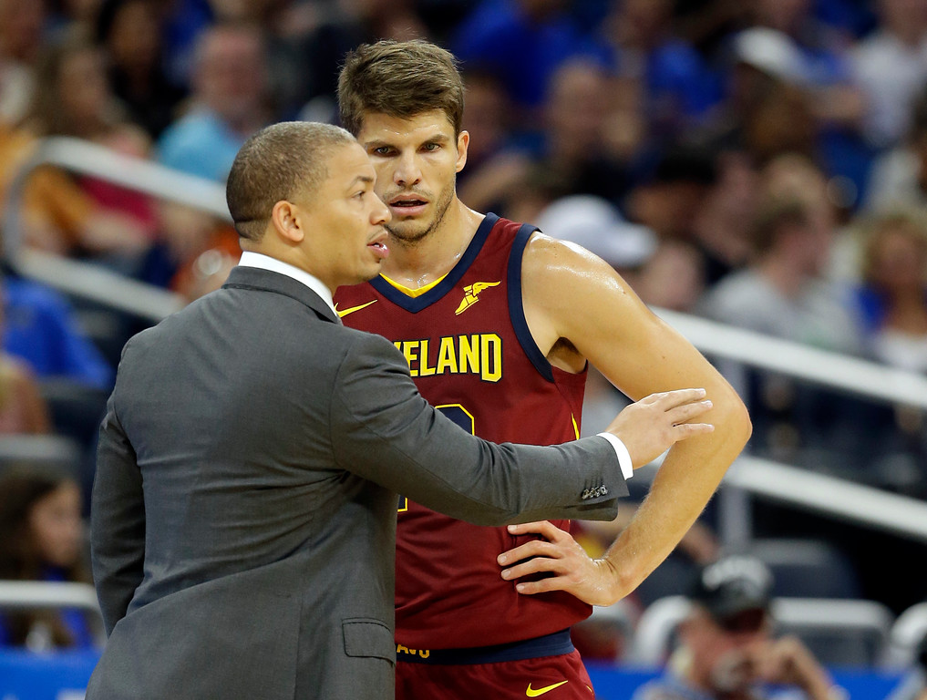 . Cleveland Cavaliers head coach Tyronn Lue, left, talks with Kyle Korver during the second half of an NBA preseason basketball game against the Orlando Magic, Friday, Oct. 13, 2017, in Orlando, Fla. Cleveland won 113-106. (AP Photo/John Raoux)
