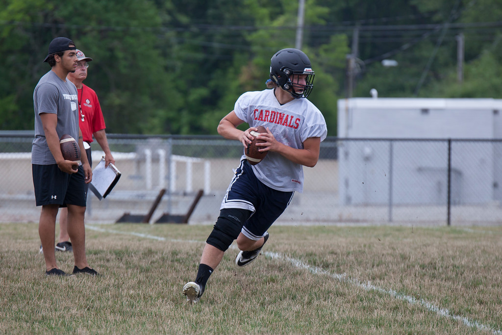 . Jen Forbus - The Morning Journal<br> Running a seven-on-seven drill, the quarterback looks for an open receiver during Brookside\'s first day of football practice on July 30.