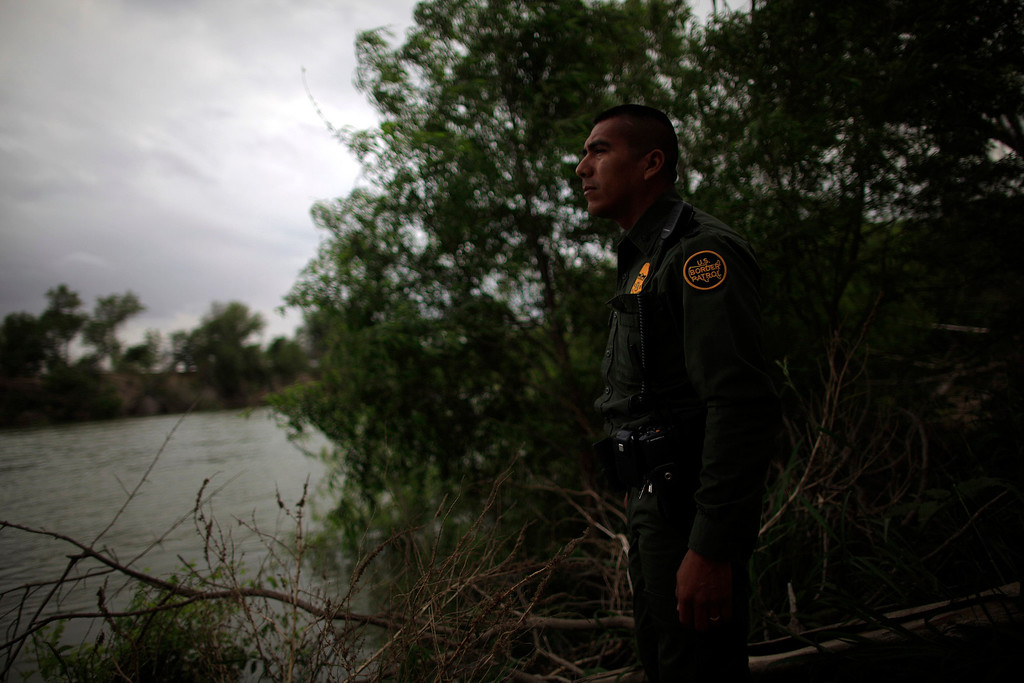 ". U.S. Border Patrol agent Daniel Tirado from the Rio Grande Valley Sector looks out at the Rio Grande river in Hidalgo, Texas March 28, 2013. Brooks County has become an epicentre for illegal immigrant deaths in Texas. In 2012, sheriff\'s deputies found 129 bodies there, six times the number recorded in 2010. Most of those who died succumbed to the punishing heat and rough terrain that comprise the ranch lands of south Texas. Many migrants spend a few days in a ""stash house\"", such as the Casa del Migrante, in Reynosa, Mexico, and many are ignorant of the treacherous journey ahead. Picture taken March 28, 2013. REUTERS/Eric Thayer"