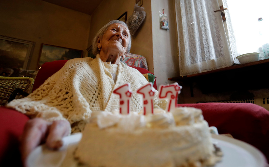 . Emma Morano holds a cake with candles marking 117 years in the day of her birthday in Verbania, Italy, Tuesday, Nov. 29, 2016.  At 117 years of age, Emma is now the oldest person in the world and is believed to be the last surviving person in the world who was born in the 1800s, coming into the world on Nov. 29, 1899. (AP Photo/Antonio Calanni)
