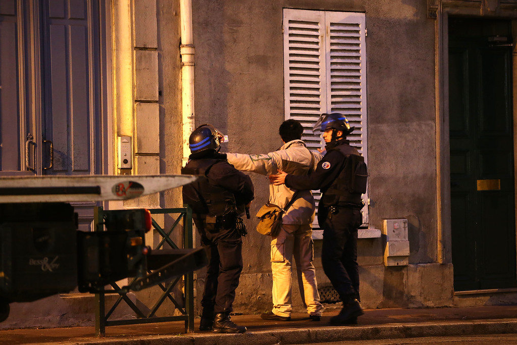. Police search a man as emergency services tend to the hostage situation at Port de Vincennes on January 9, 2015 in Paris, France. According to reports at least five people have been taken hostage in a kosher deli in the Port de Vincennes area of Paris. A huge manhunt for the two suspected gunmen in Wednesday\'s deadly attack on Charlie Hebdo magazine has entered its third day.  (Photo by Dan Kitwood/Getty Images)