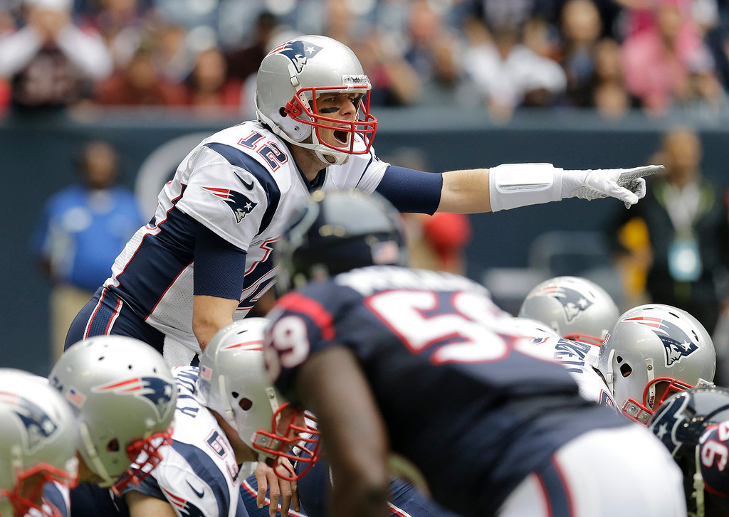 . New England Patriots\' Tom Brady calls signals against the Houston Texans during the first quarter of an NFL football game Sunday, Dec. 1, 2013, in Houston. (AP Photo/Patric Schneider)