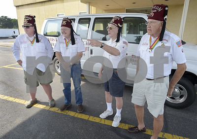 shriners-trade-their-tiny-cars-for-hospital-shuttles