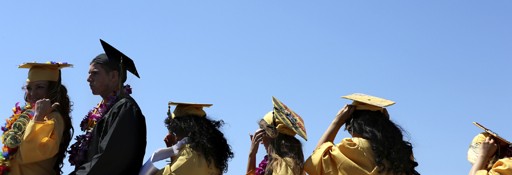 . Graduates line up on stage at the Watsonville High football field on Friday afternoon during the 2013 graduation ceremony. (Kevin Johnson/Sentinel)