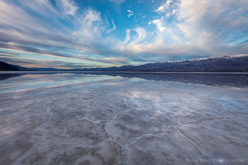A rare film of water covers Badwater Basin salt flats, and  provides beautiful reflections at sunrise.