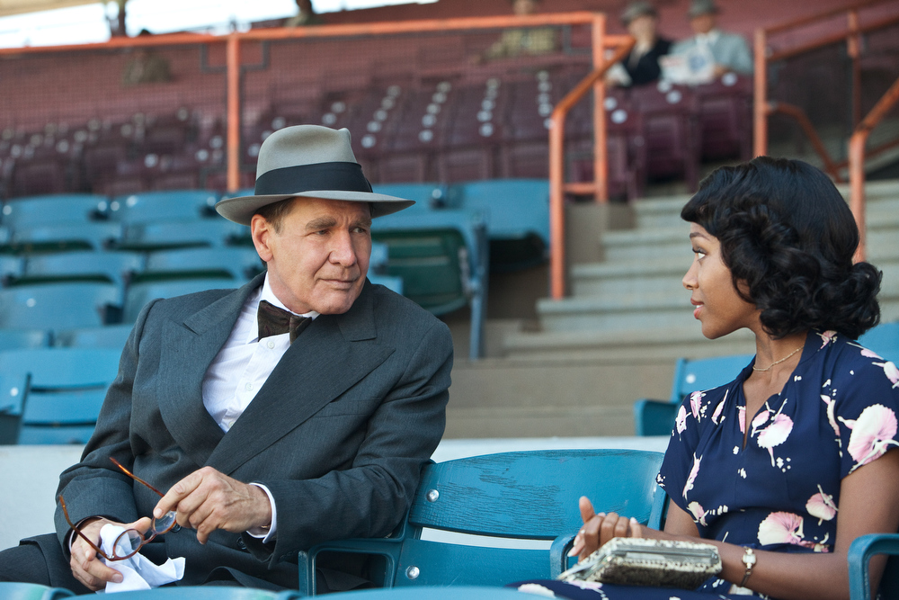 ". (L-r) HARRISON FORD as Branch Rickey and NICOLE BEHARIE as Rachel Robinson in Warner Bros. Pictures� and Legendary Pictures� drama �""42\"" a Warner Bros. Pictures release."