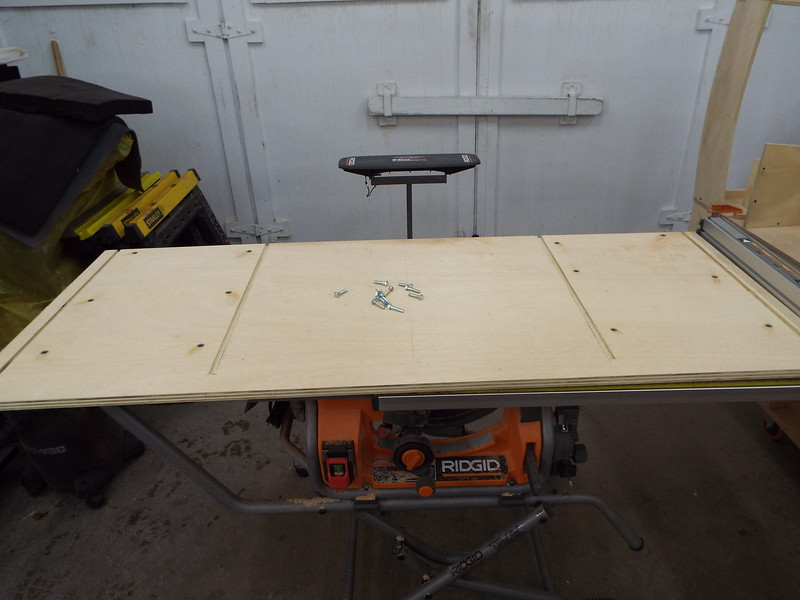 Inserts installed in the bottom of the desk top to hold it in place and also makes the top removeable if damaged.