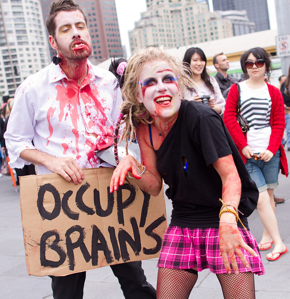 """Occupy Brains"" couple at Federation Square"