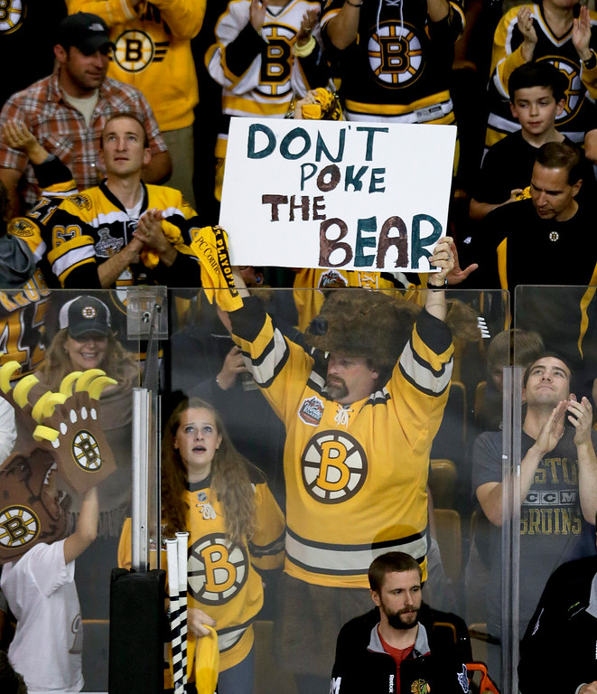 . A Boston Bruins fan shows his support  during the third period in Game 4 of the NHL hockey Stanley Cup Finals against the Chicago Blackhawks, Wednesday, June 19, 2013, in Boston. (AP Photo/Charles Krupa)