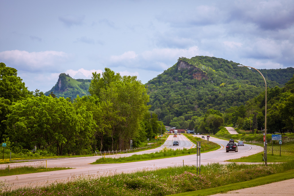 Tree-covered King's and Queens Bluff towering above US-61