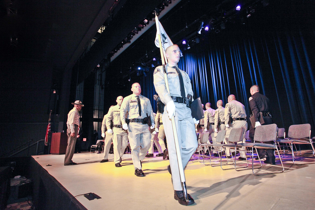 . Rio Hondo Police Academy Class of 2012-1 is led off stage by Alexander Payne after receiving their diplomas. The graduation ceremony took place Saturday July 13, 2013 at the Rio Hondo College Wray Theatre. (Correspondent photo by Chris Burt)