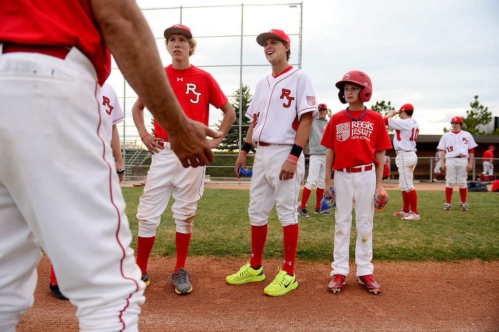 . PARKER, CO - APRIL 29: Regis Jesuit shortstop Brody Weiss (center) listens to head coach Mike Anderson with teammate Jack Griffith (left) and younger brother, Brock Weiss (right) following the team\'s final home game. Weiss is the son of Colorado Rockies manager Walt Weiss. (Photo by AAron Ontiveroz/The Denver Post)