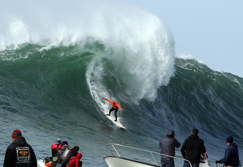 . Mavericks runner up Shane Dorian plunges down the face of a wave during the final heat of the competition at Half Moon Bay on Friday afternoon. Dorian finished second, after Grant Baker. (Kevin Johnson/Sentinel)