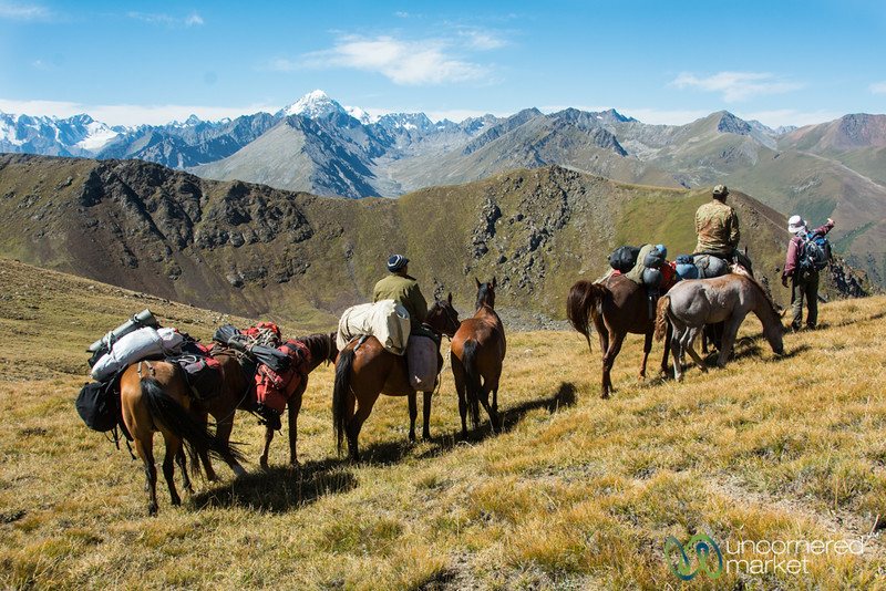 Horsemen Cross the Mountain Pass on Jyrgalan Trek, Kyrgyzstan