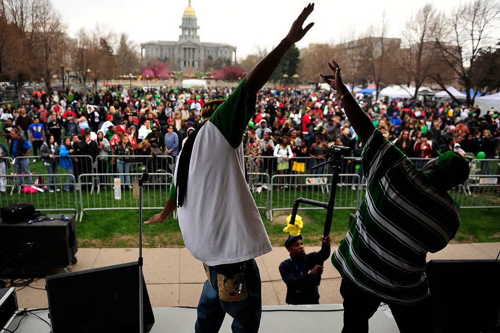 . Headache and Kevin pistol of Hustlinflow.com rap during the Annual Denver 420 Rally in Civic Center Park.      Joe Amon, The Denver Post