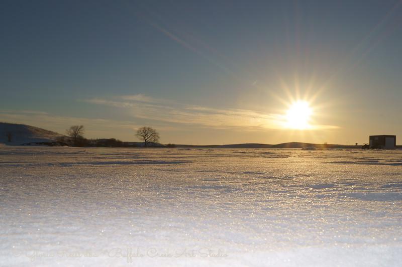sun setting across the lake, while we were ice fishing