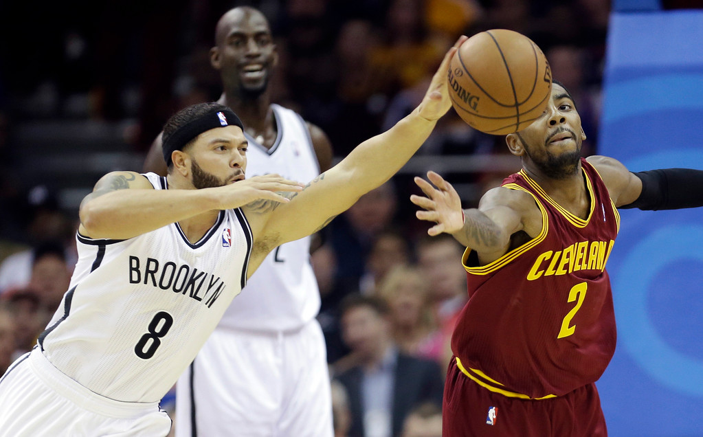 . Brooklyn Nets\' Deron Williams (8) and Cleveland Cavaliers\' Kyrie Irving (2) battle for a loose ball during the first quarter of an NBA basketball game Wednesday, Oct. 30, 2013, in Cleveland. (AP Photo/Tony Dejak)