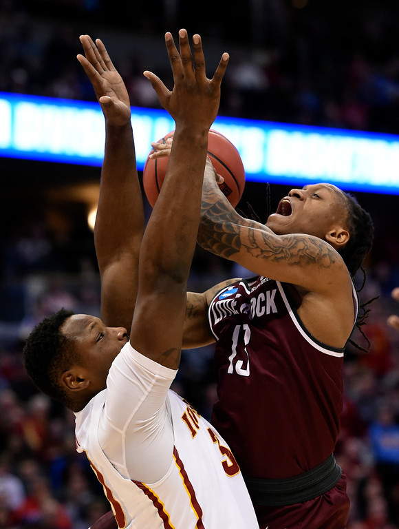 . DENVER, CO - MARCH 19: Arkansas Little Rock Trojans guard Marcus Johnson Jr. (13) draws the foul on Iowa State Cyclones guard Deonte Burton (30) in the second half during the second round of the men\'s basketball game in the NCAA Tournament March19, 2016 at Pepsi Center in Denver. Iowa State Cyclones defeated the Arkansas Little Rock Trojans 78-61. (Photo By John Leyba/The Denver Post)