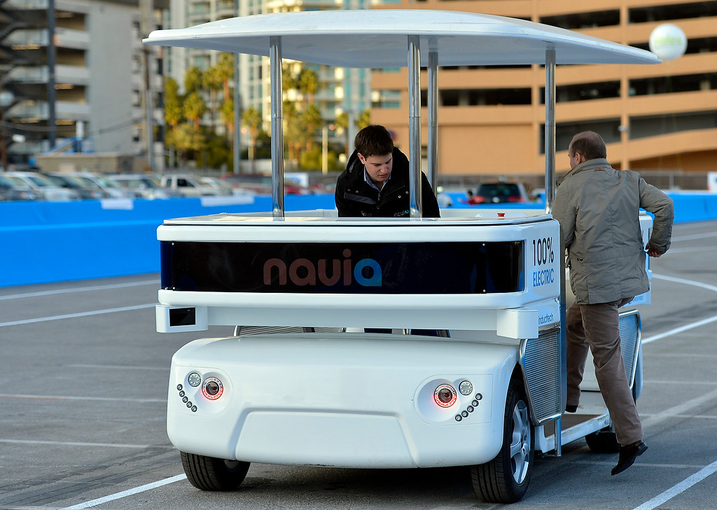 . Induct demonstrates their new Navia driverless shuttle at the International Consumer Electronics Show Monday, Jan. 6, 2014, in Las Vegas. (AP Photo/Jack Dempsey)