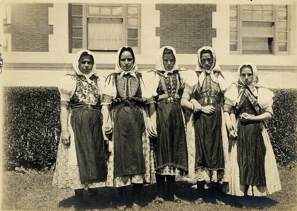 Description of . Five young females in their traditional garb. (NPS photo)